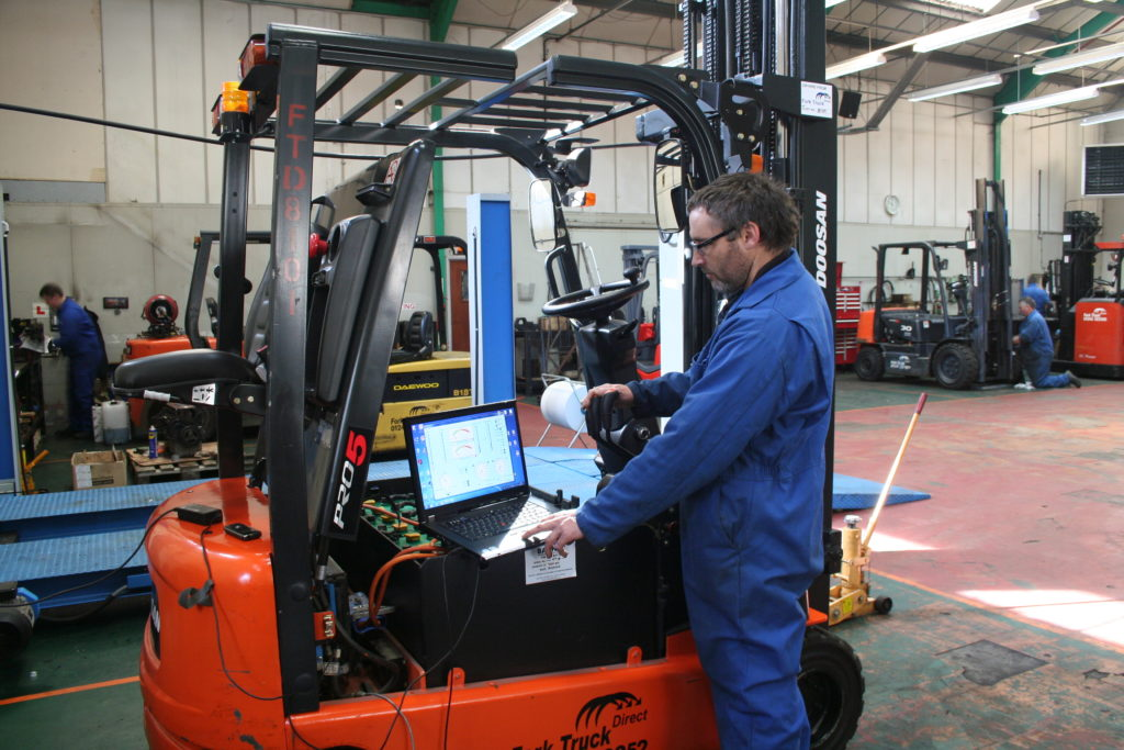 Picture of staff member working on a forktruck the company hires in Essex and Suffolk